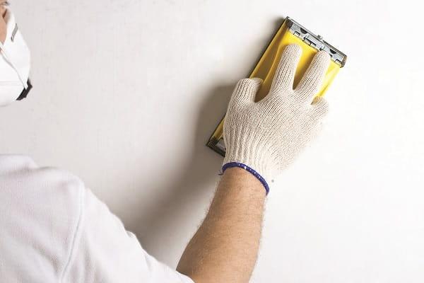 как снять штукатурку со стены вручную