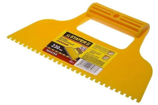 как выбрать зубчатый шпатель для укладки плитки: пластиковый инструмент